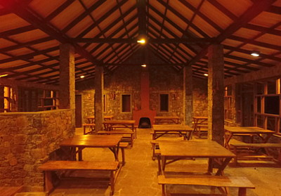 corberts restaurant tables, fireplace, rock stone dinnning area